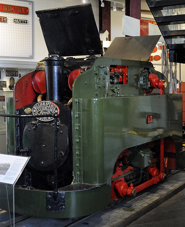 Guinness Brewery No 13, Narrow Gauge Railway Museum, Tywyn, Thurs 25 August 2011 1.   22 inch gauge 0-4-0T built in 1895, one of a number of such locos supplied for the system in the Guinness brewery in Dublin by the Cork Street Foundry, Dublin.  Designed to fit the 'loading gauge' of the horses they replaced, the cylinders are above the boiler and drive vertical connecting rods.  The locos could be fitted inside unpowered haulage trucks built to the Irish standard gauge of 5ft 3in, which the 22in gauge loco propelled by means of a friction drive from its driving wheels.