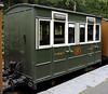 Glyn Valley Tramway coach, Abergynolwyn, Thurs 25 August 2011.  The Tramway ran west from Chirk, had a strange gauge of 2ft 4.5in, and closed in 1935.  This was its only first class coach, built in 1892 by the Midland Rly Carriage & Wagon Co.  As the yellow axle box covers show, it now rides on roller bearings!