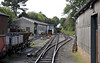 Pendre, looking west from the station, Turs 25 August 2011.  The railway's works are at left, and the carriage shed at right.   Tom Rolt's train is heading towards Tywyn.