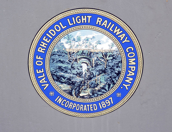 Welcome to the Vale of Rheidol Rly! Wed 24 August 2011.  As the company badge shows, it is a late-comer, not opening until 1902 to carry passengers, timber for pit props for south Wales and lead from mines in the valley.  The line was taken over by the Cambrian Rlys in 1913, and subsequently passed to the Great Western and then BR.  It survived the Beeching era and was privatised in 1989.  Initially profitable, traffic dwindled and it has relied entirely on tourist traffic from as early as 1931.  The VoR has never had volunteers; all staff are paid employees.