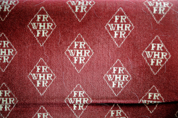 Welsh Highland Rly seat cover, Porthmadog, Mon 22 August 2011.