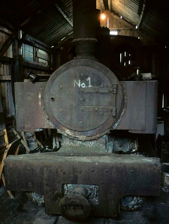 No 1 [Joffre], Becconsall shed, 1 August 1976   The 0-6-0T is one of 70 600mm gauge locos built for the French artillery in World War I by Kerr Stuart (2405 / 1915).  (Joffre was the French C in C 1914-1916.)  Five survived at a quarry near Calais; all have been repatriated.  2405 came to Lancashire in 1974, and restoration began in 1995.  Photo by Les Tindall.