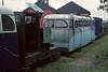 No 7, West Lancashire Light Railway, 1 August 1976.  Motor Rail 4wDM 8992 / 1946, between two Southport pier coaches.  Photo by Les Tindall.