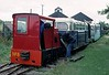 No 8, West Lancashire Light Railway, 1 August 1976.  Hudson - Hunslet 4wDM 4478 / 1953 being started up.  A Southport pier coach and No 7 are beyond, then another Southport pier coach.  Photo by Les Tindall.