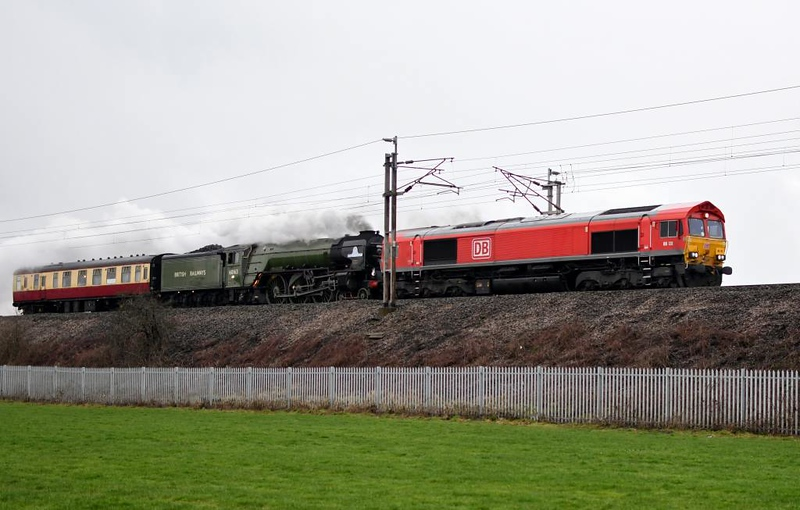 66131 & 60163 Tornado, 5Z63, Carnforth, Sat 2 March 2019 - 0752.  DB's early 0830 Carnforth - Doncaster move via Shap, Hexham and the ECML to position Tornado for its Auld Reekie tour the following day to Edinburgh.  This was Tornado's first tour since it suffered serious damage on the ECML near Sandy on 14 April 2018, and was completed successfully. Unfortunately 55009 failed on the return at Berwick. The move had been booked to use the Upperby through siding but it was closed because of a sigalling problem so the locos ran via Citadel and Currock Junction. 66131 had run light from Carlisle yard (0Z66, 0500) to Carnforth to escort 60163.