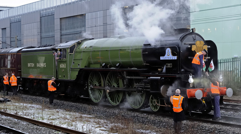 60163 Tornado, Preston, Thurs 4 February 2010 2 - 0835     Welsh flags are mounted on the buffer beam to complement the Prince of Wales's feathers.