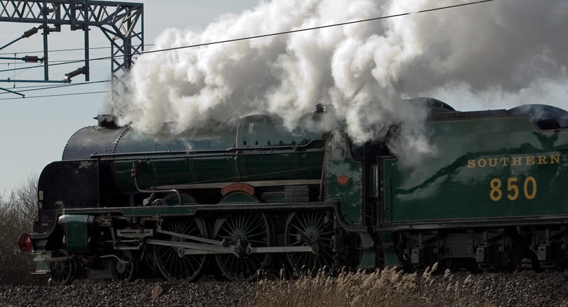 850 Lord Nelson, 5Z52, Bolton-le-Sands, 8 March 2007 - 1420.  Lord Nelson sets off from Carnforth for Minehead with its support coach.  It was five hours late, having derailed its tender in Carnforth Steamtown after its test run the previous day.