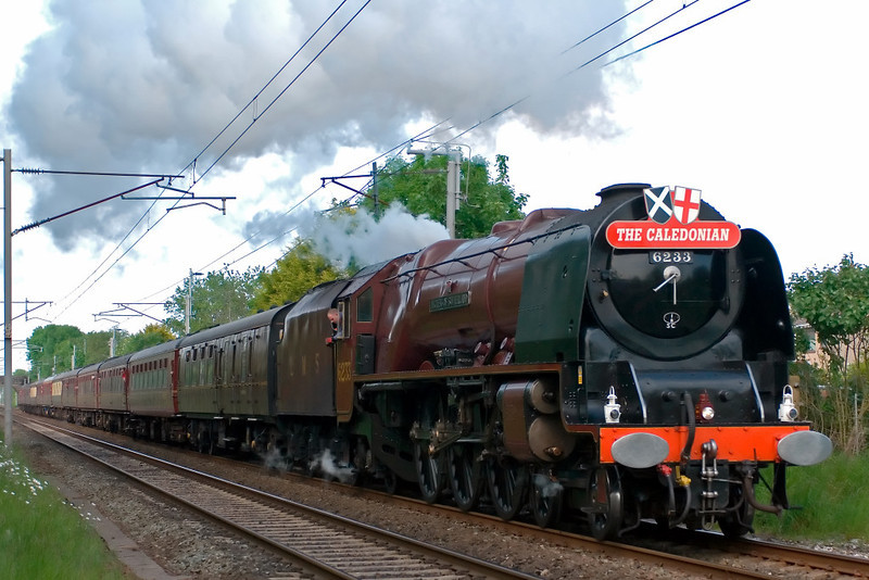 6233 Duchess of Sutherland, 1Z62, Carnforth, 24 May 2008 - 1732    The Duchess powers away from its water stop at Carnforth with the return leg of PMR Tours' Gloucester - Carlisle Citadel Express.  6233 worked the train from Crewe to Carlisle and back, both ways over Shap.