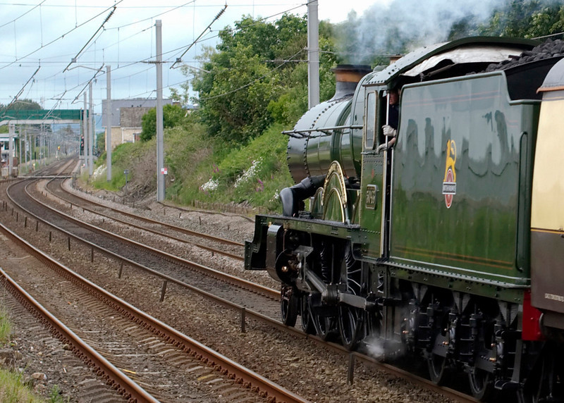 5043 Earl of Mount Edgecumbe, 1Z80, Hest Bank, 20 June 2009 - 1140 2     The driver eases off as he spots the double yellow for Carnforth, where the loco was booked to take on coal and water at Steamtown.