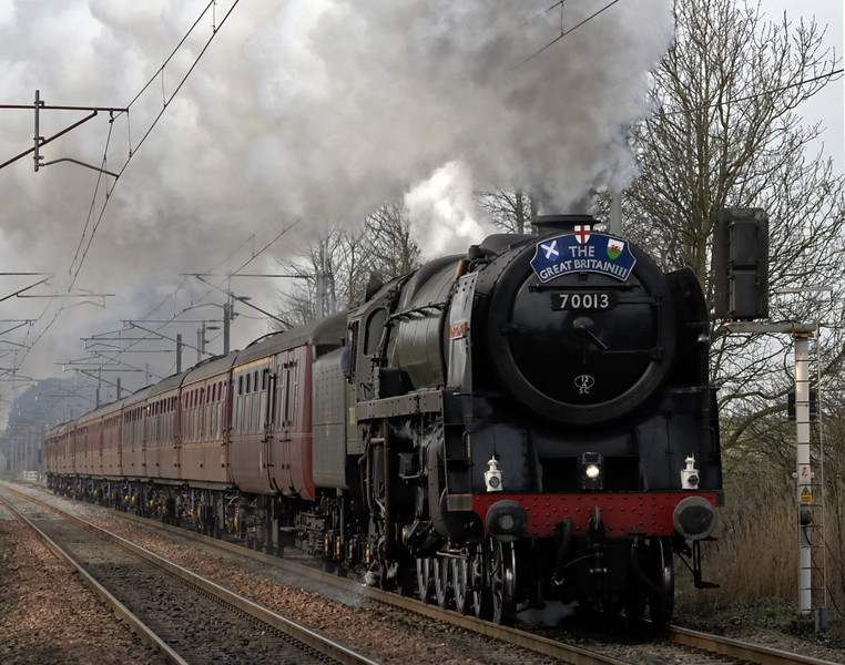 70013 Oliver Cromwell. 1Z60, Carnforth, Fri 9 April 2010 - 0942     The Brit whistles as it powers north with the Preston - Glasgow leg of the Rly Touring Co's 'Great Britain III' round - Britain marathon.