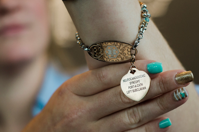 Brittany Brassard, who suffers from chronic Lyme Disease, shows off her medical bracelet on Thursday, July 27, 2017. SENTINEL & ENTERPRISE / Ashley Green