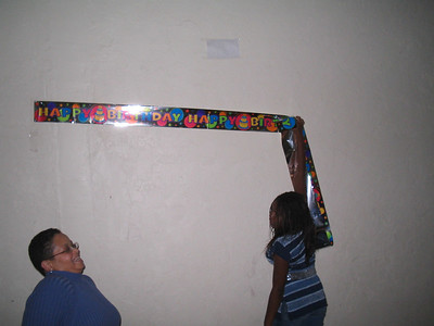 Putting up the Happy Birthday Banner