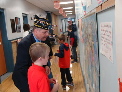 John Brewer - Oneida Daily Dispatch Veterans talk with fourth grade students at North Broad Elementary School in Oneida as part of their annual Veterans Day program on Thursday, Nov. 10, 2016.