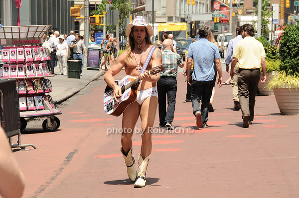 Naked Cowboy at work<br /> all photos by Rob Rich © 2010 robwayne1@aol.com 516-676-3939