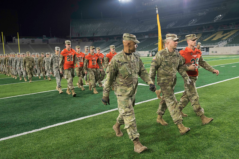 CSU's ROTC leaves the on-campus stadium for the 50th annual Bronze Boot relay to the Wyoming border with the game ball for the Border War at on Friday, November 3, 2017.
