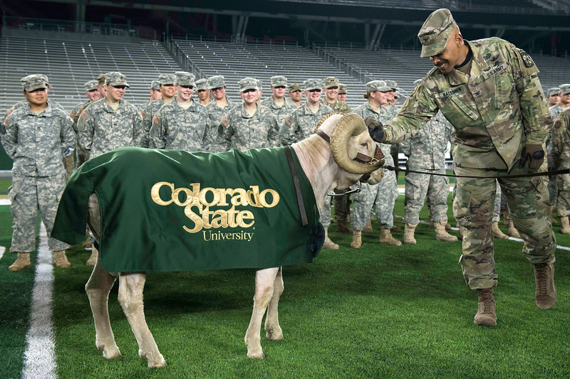 Col. Jason Halloren pets Cam the Ram at CSU's on-campus stadium before the 50th annual Bronze Boot relay on Friday, November 3, 2017.
