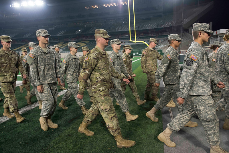 Thompson Valley High School graduate Tory Hass, center, and other CSU ROTC  cadets leave CSU's on-campus stadium for the 50th annual Bronze Boot relay to the Wyoming border on Friday, November 3, 2017.