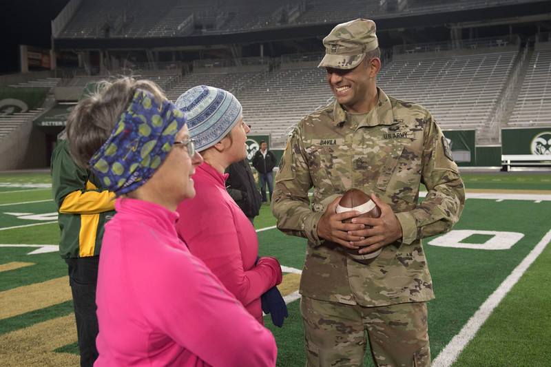 Master Sgt. Franklin Davila talks with Jody Donovan and Lisa Chandler at CSU's on-campus stadium before the 50th annual Bronze Boot relay on Friday, November 3, 2017. This year was the first that the public was invited to join the ROTC on the first mile of the run.