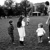 Boston Common. A father playing with a group of children. They were amazingly cool about letting me into their space with my camera.