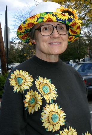 Market Master, Arlene Flowers (that's her real name). Her granddaughter made her the sweatshirt, she bought the hat to go with a yellow VW Bug that she owned. Arlene runs the market.