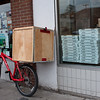 The Upper Crust pizzeria. This is their delivery wagon. The pizza always smells good when I walk by, but it's not kosher, which I could forgive, but it's much too crispy for my taste.