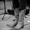 The fiddler's cowgirl boots.