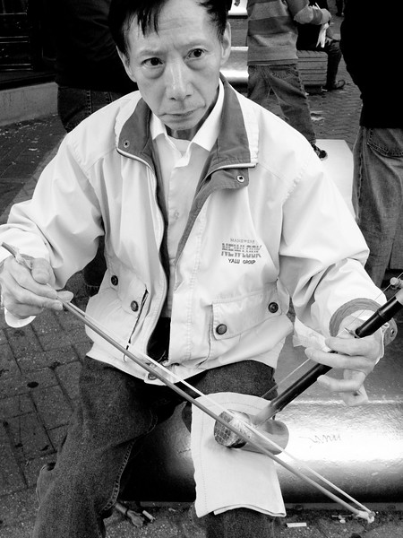 I see this gentleman downtown, at Park Street Station, often, playing his Chinese, one-string violin.