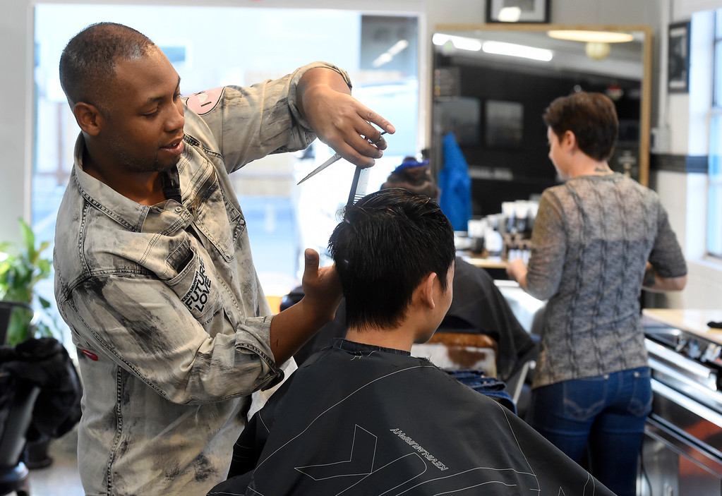 . BOULDER, CO - November 28, 2018: Ja\'Mal Gilmore cuts the hair of Sam Karman at the Brooklyn Barber Academy in Boulder on November 28, 2018. (Photo by Cliff Grassmick/Staff Photographer)