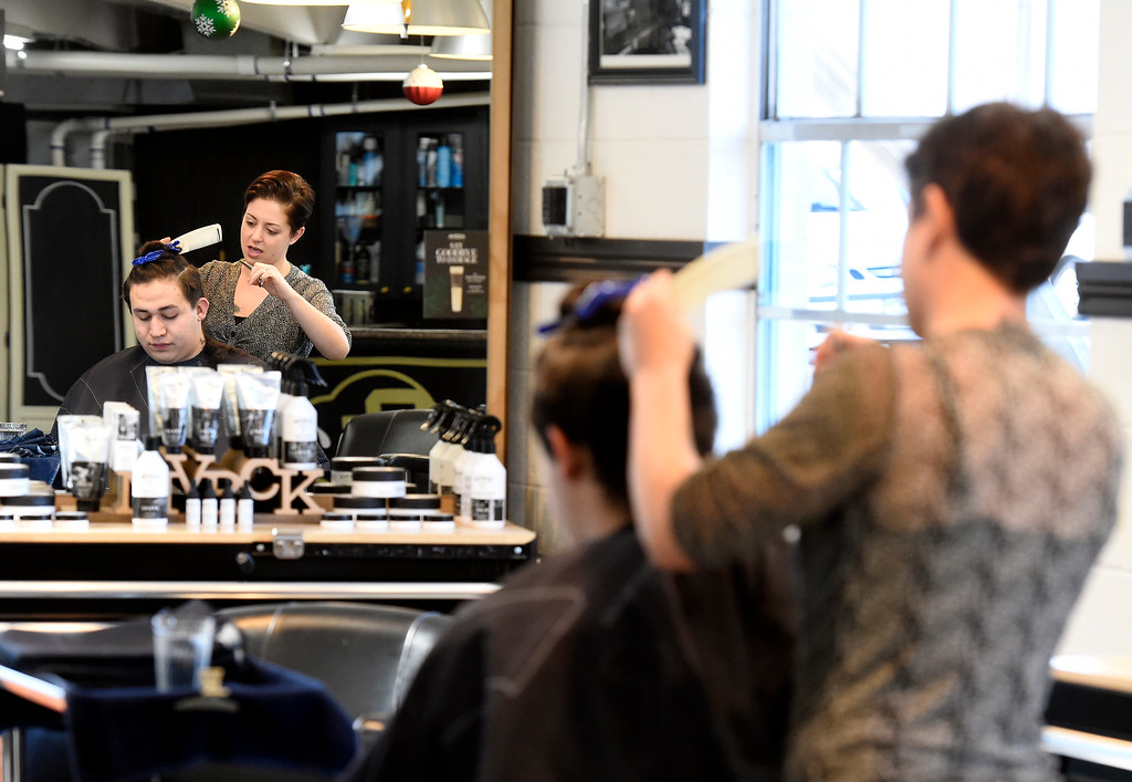 . BOULDER, CO - November 28, 2018: Stacy Rahall cuts the hair of Jose Noriega at the Brooklyn Barber Academy in Boulder on November 28, 2018. (Photo by Cliff Grassmick/Staff Photographer)