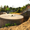 This 8,000 gallon cistern will be underground when the garden is finished. It collects rainwater from adjacent roofs and will be used to water this community garden.  Hazel Heights P-Patch, Seattle.