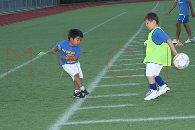 BROOKLYN - July 6: Players compete at Brooklyn Italians Soccer Academy Practice at John Dewey Field in Brooklyn, NY.