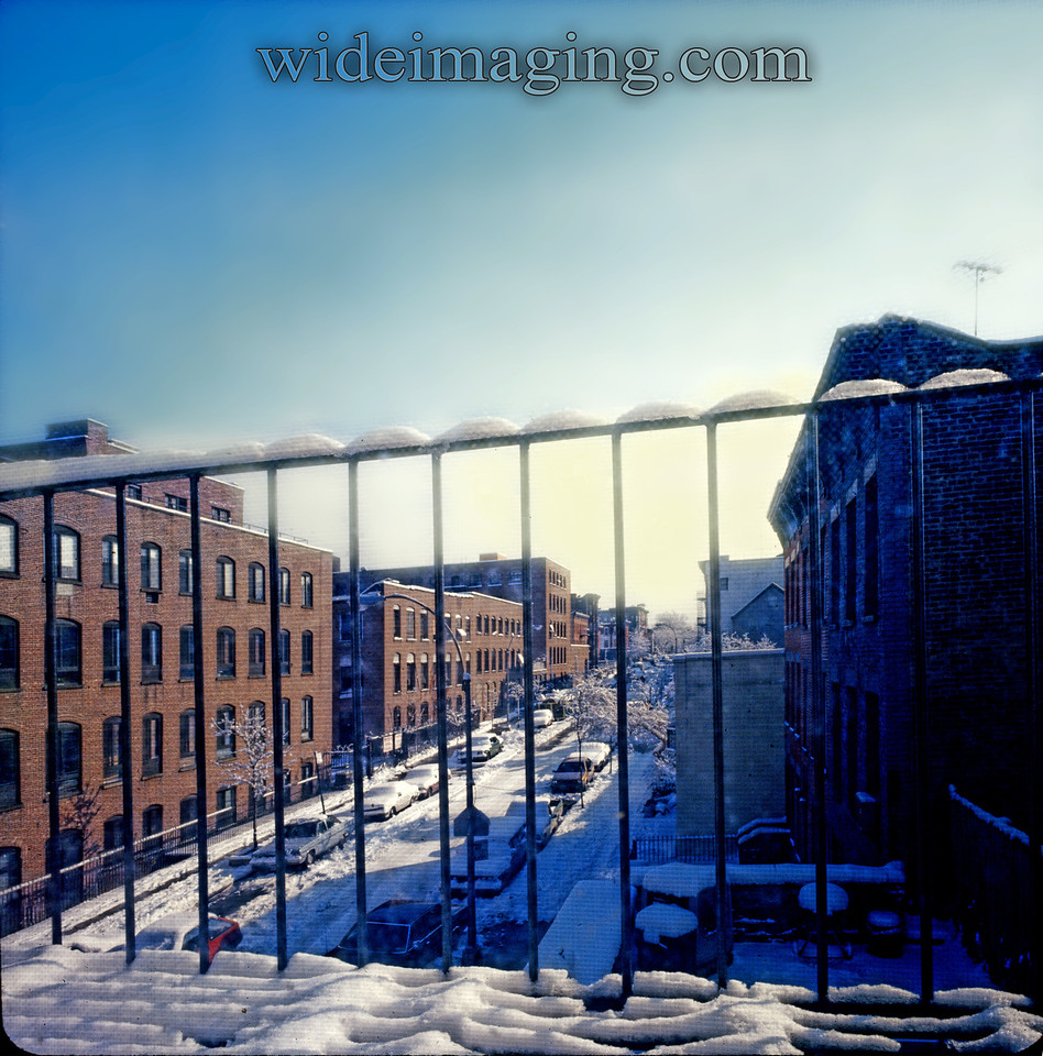 View looking down 13th Street toward Prospect Park from 7th ave. The former Ansonia clock factory and warehouse is to the left. February 1987.