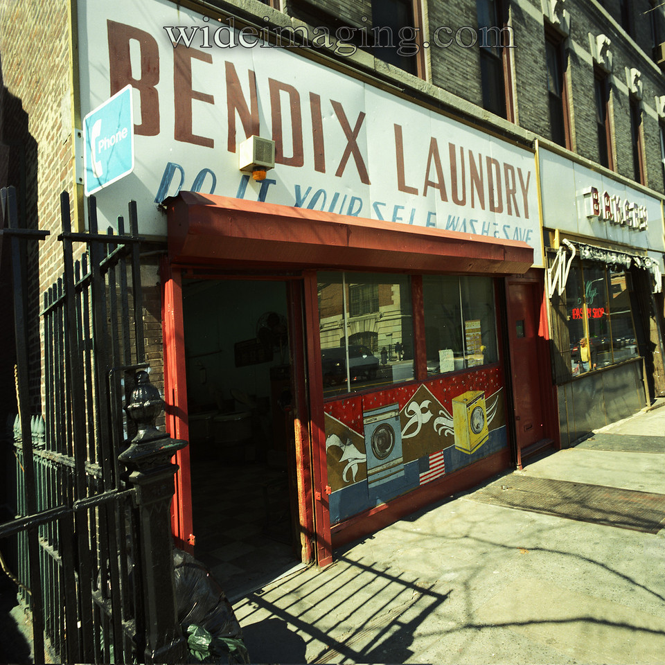 The Bendix Laundromat on 7th Ave. near 6th street in Park Slope, from the Fall of 1988. (see the side by side comparison photos in this gallery) Bendix Aviation licensed the name to an appliance corporation, who actually made washing machines, in 1936. At the time I worked for Bendix Aerospace in New Jersey and took this photo as a joke.