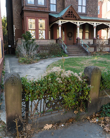 The original ironwork and concrete posts out front.