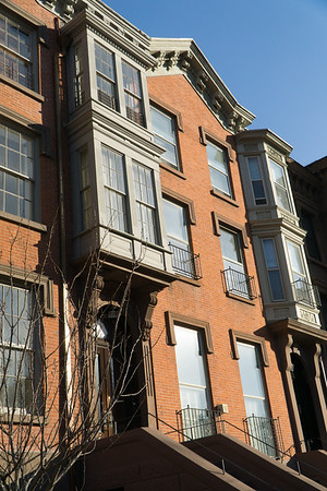 Corbelled and stacked bay windows on these town houses. A corbel is the support underneath the window.