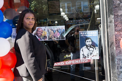 NYC's Public Advocate Tish James was on han d to help with grand opening of the new Foodtown market in Prospect Heights. She stands in front of the tribute to recently-deceased Brooklyn DA, Ken Thompson.