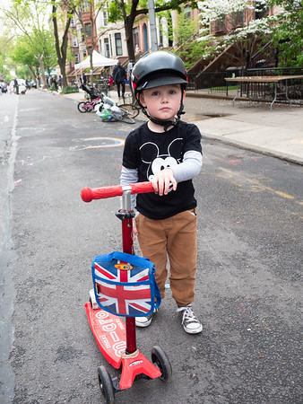 A boy and his scooter at party's end.