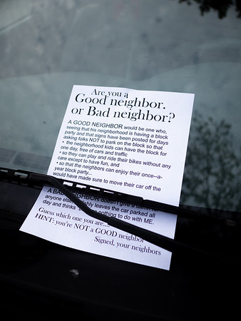 A note to neighbors who ignored NO PARKING signs to please to remove their parked cars for the day.