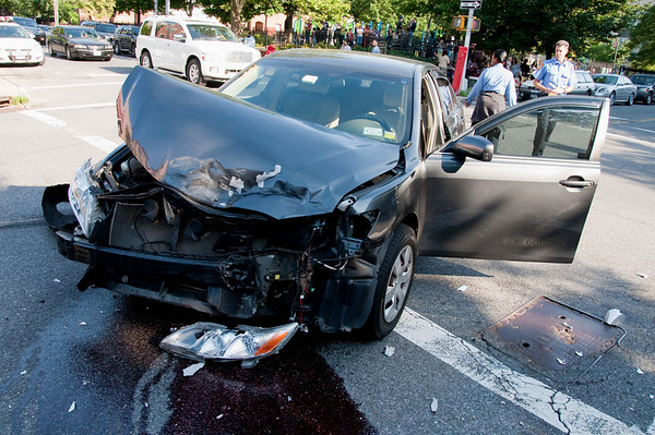 This car was coming west on Prospect Place when it collided with another car going north on Underhill Avenue. One or the other ran the red light. Notice the playground in the background, filled with children and parents.
