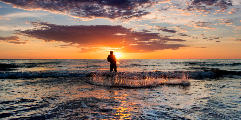 net fishing at sunset along the coast of broome