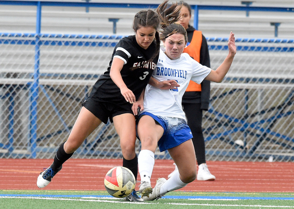. Broomfield High School\'s Cara Quinn fights for the ball with Sarina Russ during a CHSAA State 5A Quarterfinal game against Fairview on Wednesday in Broomfield. Broomfield won the game 4-1. More photos: www.bocopreps.com Jeremy Papasso/ Staff Photographer/ May 17, 2017