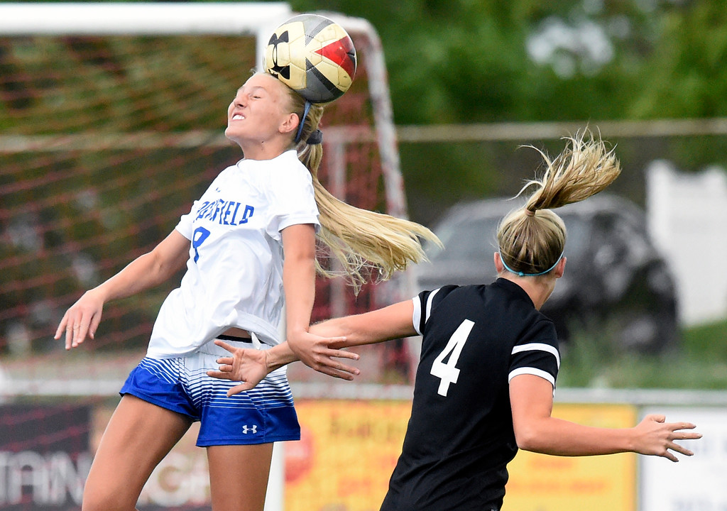 . Broomfield High School\'s Marina Davidson heads the ball during a CHSAA State 5A Quarterfinal game against Fairview on Wednesday in Broomfield. Broomfield won the game 4-1. More photos: www.bocopreps.com Jeremy Papasso/ Staff Photographer/ May 17, 2017