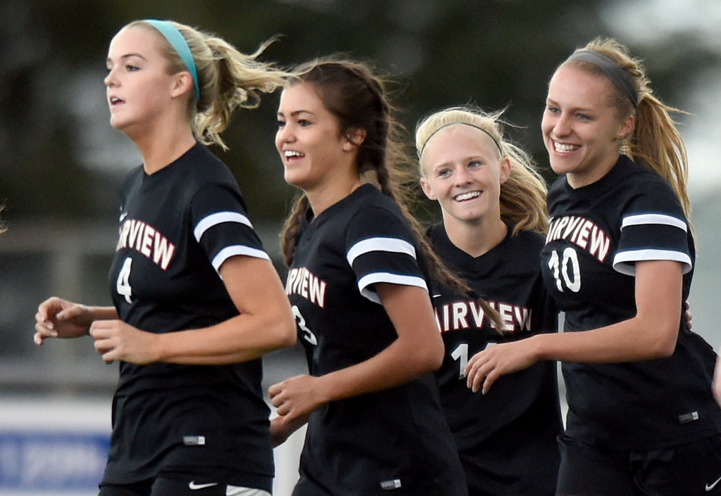 . Fairview High School\'s Olivia Hays, at right, Mannon Frykholm, Sarina Russ and Tea Smith celebrate a goal during a CHSAA State 5A Quarterfinal game against Broomfield on Wednesday in Broomfield. Broomfield won the game 4-1. More photos: www.bocopreps.com Jeremy Papasso/ Staff Photographer/ May 17, 2017