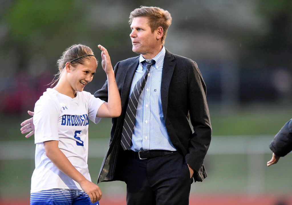 . Broomfield High School\'s Gia Lemley is congratulated on her game by head coach Jim Davidson during a CHSAA State 5A Quarterfinal game against Fairview on Wednesday in Broomfield. Broomfield won the game 4-1. More photos: www.bocopreps.com Jeremy Papasso/ Staff Photographer/ May 17, 2017