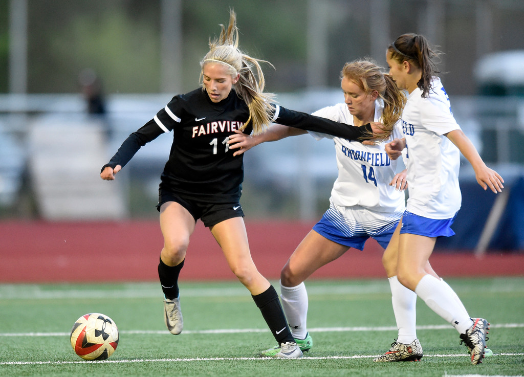 . Fairview High School\'s Skylar Anderson moves the ball away from a swarm of defenders including Elle Webber, at center, during a CHSAA State 5A Quarterfinal game against Broomfield on Wednesday in Broomfield. Broomfield won the game 4-1. More photos: www.bocopreps.com Jeremy Papasso/ Staff Photographer/ May 17, 2017