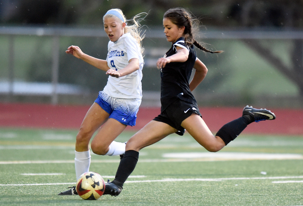 . Fairview High School\'s Sarina Russ takes a shot on goal in front of Marina Davidson during a CHSAA State 5A Quarterfinal game against Broomfield on Wednesday in Broomfield. Broomfield won the game 4-1. More photos: www.bocopreps.com Jeremy Papasso/ Staff Photographer/ May 17, 2017