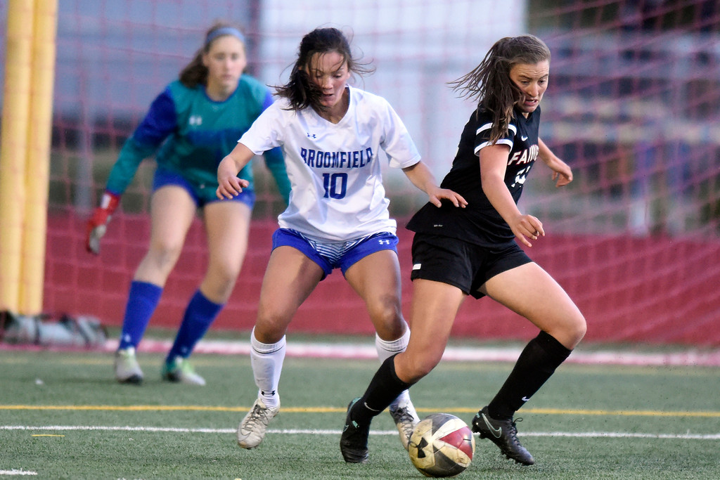 . Fairview High School\'s Mannon Frykholm tries to move in on goal past Cara Quinn during a CHSAA State 5A Quarterfinal game against Broomfield on Wednesday in Broomfield. Broomfield won the game 4-1. More photos: www.bocopreps.com Jeremy Papasso/ Staff Photographer/ May 17, 2017