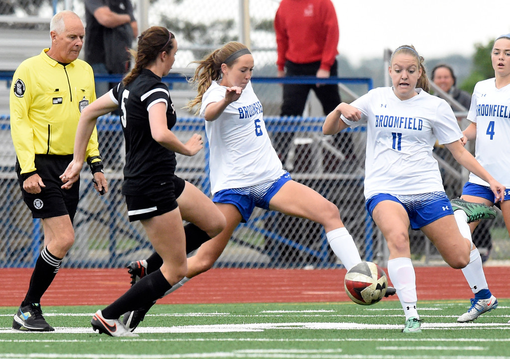 . Broomfield High School\'s Ashley Tuccio moves the ball past Julia Masciarelli during a CHSAA State 5A Quarterfinal game against Fairview on Wednesday in Broomfield. Broomfield won the game 4-1. More photos: www.bocopreps.com Jeremy Papasso/ Staff Photographer/ May 17, 2017