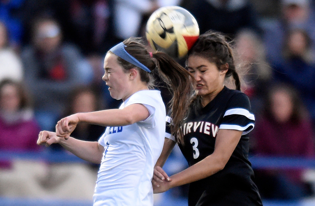 . Broomfield High School\'s Emily Galvin and Sarina Russ go for a header during a CHSAA State 5A Quarterfinal game against Fairview on Wednesday in Broomfield. Broomfield won the game 4-1. More photos: www.bocopreps.com Jeremy Papasso/ Staff Photographer/ May 17, 2017