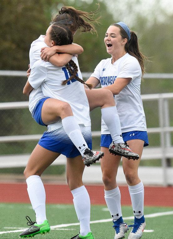 . Broomfield High School\'s Gia Lemley jumps into the arms of Tessa Wagner after scoring a goal during a CHSAA State 5A Quarterfinal game against Fairview on Wednesday in Broomfield. Broomfield won the game 4-1. More photos: www.bocopreps.com Jeremy Papasso/ Staff Photographer/ May 17, 2017